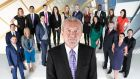 Lord Alan Sugar and some of his Apprentice contestants. The entrepreneur said people appreciate his blunt manner.
