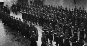 Men of the Royal Irish Constabulary under inspection in Derry city in 1913. The RIC existed across the whole of pre-partition Ireland, which makes it part of what some call 'shared history'. Photograph: Hulton Archive/Getty