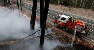 Firefighters manage a controlled burn to help contain a larger fire near Falls Creek, Australia.  Photograph: Rick Rycroft/AP