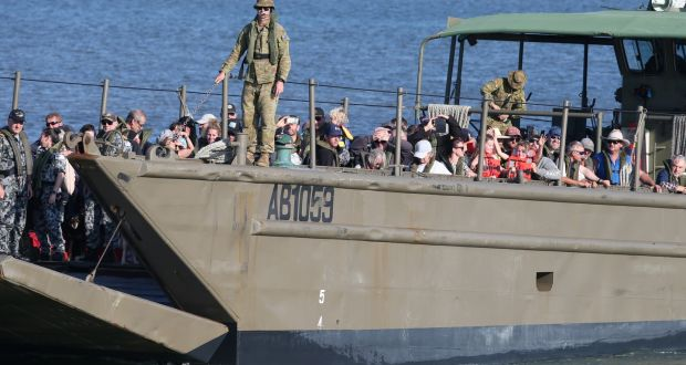 Evacuees from the bushfires are brought to shore on landing crafts in Hastings, Victoria on Wednesday. 66  firefighters and 205 evacuees arrived in Hastings from Mallacoota. Photograph: David Crosling/EPA