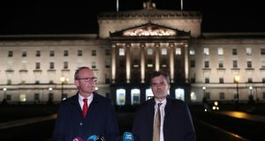 Tánaiste Simon Coveney and Northern Secretary Julian Smith issue a statement outside  Stormont on Thursday night. Photograph: Niall Carson/PA Wire