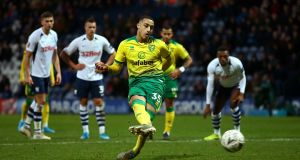 Norwich City's Adam Idah scores his side's fourth goal and completes his hat-trick from the penalty spot in the FA Cup third-round tie against Preston North End at Deepdale. Photograph:  Dave Thompson/PA Wire