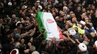 Mourners in Tehran carry the casket of Iranian military commander Qassem Suleimani. Photograph: AFP via Getty Images