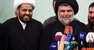 Sheikh Qais Al-Khazali (left), the Iraqi secretary general of  AAH, which was originally part of the so-called Mahdi Army led by cleric Muqtada al-Sadr (right). Photograph: Haidar Hamdani/ AFP via Getty Images