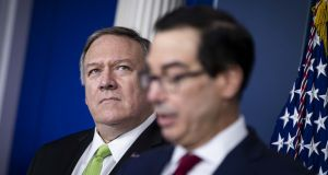 US secretary of state Mike Pompeo listens as treasury secretary Steven Mnuchin speaks during a briefing at the White House in Washington DC on Friday. Photograph: Al Drago/Bloomberg