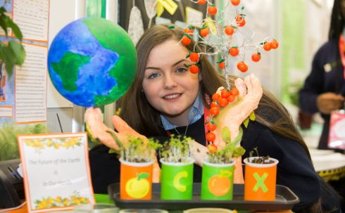 CITRUS PROJECT: Leah Shaw from Our lady?s bower athlone Westmeath with exhibit 'Citrus peels the answer to global drought' at the BT Young Scientist Exhibition in the RDS, Dublin. Photograph: Gareth Chaney/Collins