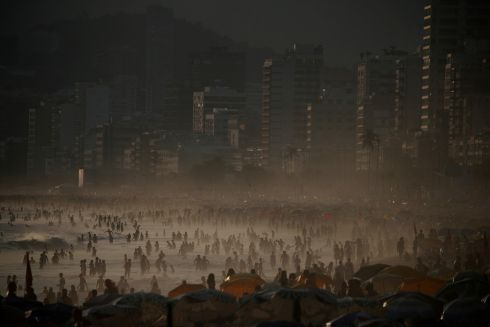 IPANEMA: People gather in Ipanema beach in Rio de Janeiro, Brazil. Photograph: Ricardo Moraes/Reuters