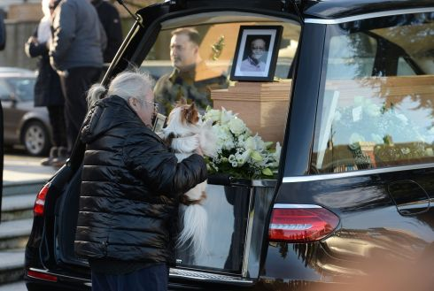 GOGAN: Clare Turner and her dog Ranger from Dun Laoighre say goodbye to Larry Gogan after at the funeral mass at the Church of St Pius X, Tempelogue. Photograph: Alan Betson/The Irish Times