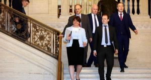 DUP leader Arlene Foster leads her party MLAs back into the debating chamber in Stormont on Saturday. Photograph:  Paul Faith/AFP/Getty