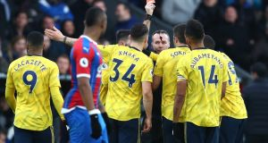 Referee Paul Tierney shows a red card to Pierre-Emerick Aubameyang of Arsenal   at Selhurst Park. Photo: Dan Istitene/Getty Images