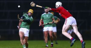 Limerick's Tom Morrissey shoots under pressure from Cork's Chris O'Leary. Photograph: Ken Sutton/Inpho