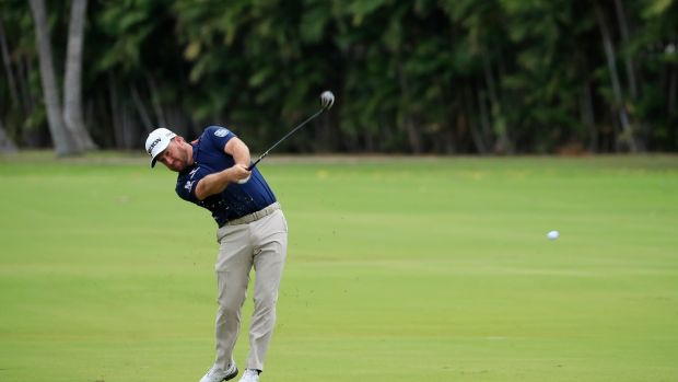 Graeme McDowell plays a shot on the ninth hole during the third round of the Sony Open in Hawaii at the Waialae Country Club in Honolulu, Hawaii. Photograph: Cliff Hawkins/Getty Images