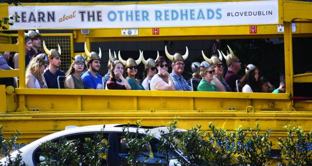 Tourists enjoy an excursion around Dublin offered by Viking Splash Tours. File photograph: Getty