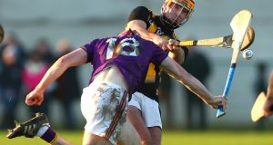Wexford's Michael Furlong blocks Billy Ryan of Kilkenny during the Bord na Mona Walsh Cup semi-final at  John Lockes in  Callan. Photograph: Tom O'Hanlon/Inpho