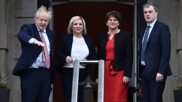 Irish backstop - British prime Minister Boris Johnson and Secretary of State for Northern Ireland, Julian Smith are greeted by First Minister, Arlene Foster of the DUP and Deputy First Minister Michelle O'Neill of Sinn Féin at Stormont. Photograph: Charles McQuillan/Getty