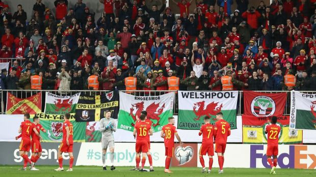 Wales players applaud their fans after their Euro 2020 qualifier against Azerbaijan in Baku last November. Photo: Aziz Karimov/Getty Images
