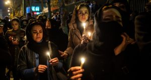 Demonstrators on Saturday hold candles while gathering during a vigil for the victims of the Ukraine International Airlines flight that was unintentionally shot down by Iran, in Tehran. Iran admitted it unintentionally shot down a Ukrainian jetliner that it mistook for a cruise missile, a dramatic reversal after days of denials that triggered international condemnation and protests in the streets of Tehran. Photograph: Ali Mohammadi/Bloomberg