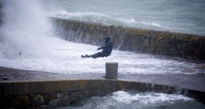 Storm Brendan: A man is caught by a high wave at Coliemore Harbour Dalkey, Co Dublin. Photograph: Tom Honan/The Irish Times