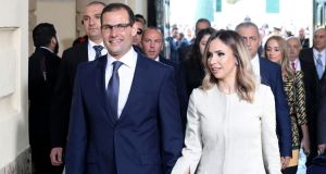 Malta's newly elected prime minister Robert Abela and his wife Lydia  arrive at the Grandmaster's Palace in Valletta, Malta on Monday. Photograph: Domenic Aquilina/EPA