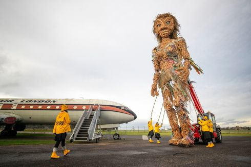 STORM WARNING: Puppeteers from the Vision Mechanics performing arts group rehearse with Scotland's largest puppet, a 10-metre tall sea goddess called Storm, in the grounds of the Museum of Flight, East Lothian. Storm, made of recycled materials, was unveiled ahead of her debut at the Celtic Connections Coastal Day celebrations in Glasgow. Photograph: Jane Barlow/PA Wire