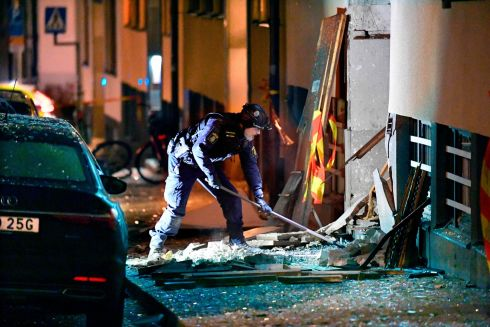 STOCKHOLM BLAST: Police search for clues after an explosion damaged a residential building in central Stockholm, Sweden, on Monday. Several nearby cars were also damaged by the blast, the cause of which was not known, in the affluent neighbourhood of Ostermalm. Photograph: Anders Wiklund/AFP/Getty