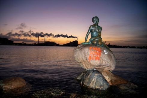 "SPREADING THE WORD: Graffiti which reads ""Free Hong Kong"" daubed on the Little Mermaid statue in Copenhagen, Denmark, referring to ongoing public unrest in the Chinese city. Photograph: Thomas Sjoerup/EPA"