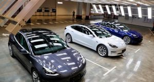 Tesla Model 3 cars are displayed during the Tesla China-made Model 3 Delivery Ceremony in Shanghai this month. Photograph: STR/AFP via Getty Images