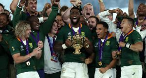 Siya Kolisi, the South Africa captain, celebrates with team mates after their victory during the Rugby World Cup 2019 Final between England and South Africa at the International Stadium in Yokohama.  Photograph:  David Rogers/Getty Images