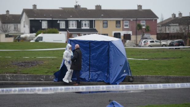 A cover has been placed over the human remains found in Coolock on Monday night. Photograph: Dara Mac Dónaill/The Irish Times