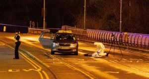 Gardaí at the scene of a shooting on the Bridge of Peace  in Drogheda on Monday night. Photograph:  Ciara Wilkinson