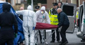 Gardaí remove the remains on Tuesday morning at the scene of the discovery of human body parts at the junction of Moatview Gardens and Moatview Drive in Darndale, Dublin,  on Monday night. Photograph: Colin Keegan, Collins