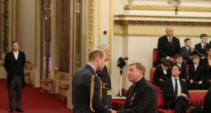 Fr Brian D'Arcy is made an OBE (Officer of the Order of the British Empire) by the Duke of Cambridge Prince William at Buckingham Palace. Photograph: Jonathan Brady/PA Wire