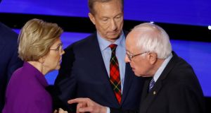 Democratic presidential candidate Elizabeth Warren, businessman Tom Steyer and Bernie Sanders after a Democratic debate hosted by CNN. Photograph: Patrick Semansky/AP.