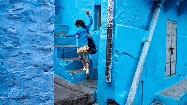 A girl runs up steps in Jodhpur, India. Photograph: Poras Chaudhary/The New York Times