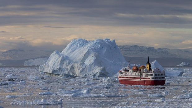 A ship passes through Disko Bay in Greenland. Photograph: Carsten Egenvang/The New York Times