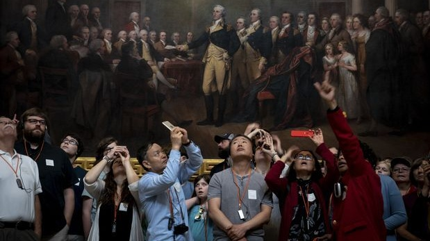Tourists visit the Capitol in Washington. Photograph: Erin Schaff/The New York Times