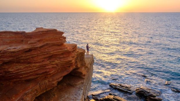 A man fishes off a cliff at Gantheaume Point, Broome, in the Kimberley Region of Australia. Photograph: Asanka Brendon Ratnayake/The New York Times