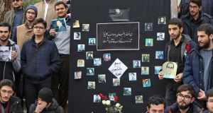 Students hold pictures of victims of last week's plane crash in Iran at the University of Tehran on Tuesday. Photograph: Atta Kenare/AFP via Getty Images
