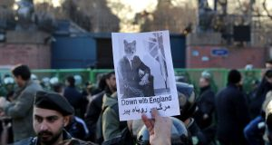 A pro-government protester holds up a placard during a demonstration in front of the British Embassy in Tehran on Sunday. Photograph /Ebrahim Noroozi