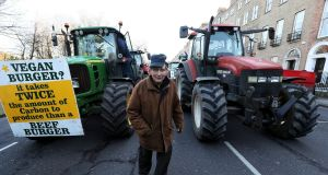 Vincent Black, a farmer from Cavan, among tractors parked on Merrion Square in Dublin city centre as a protest by farmers over the prices they get for their produce continues. Photograph: Brian Lawless/PA