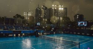 Heavy rain falls during an Australian Open practice session at Melbourne Park. Photograph: Scott Barbour/EPA