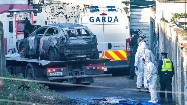 Gardai remove the burnt out vehicle on Trinity Terrace, Drumcondra, where parts of Keane Mulready Woods' body were found in a burned out car. Photograph: Colin Keegan/Collins Dublin