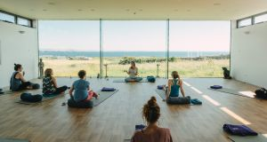 Michelle Moroney teaching a yoga class during her Cliffs of Moher retreat