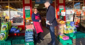 Sinn Féin's Martin Kenny TD canvassing Karen Dockery from Annaghduff, Co Leitrim, in Carrick-on-Shannon. Photograph:  Brian Farrell