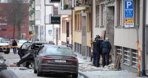 Police examine the site where an explosion damaged a residential building and cars in central Stockholm on Sunday. Photograph: Janerik Henriksson/EPA