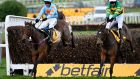 Barry Geraghty riding Defi Du Seuil (green) clear the last to win The Betfair Tingle Creek Chase from Un De Sceaux (blue) and Paul Townend at Sandown in December. Photograph:   Leo Mason/Popperfoto via Getty Images