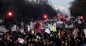 People march in Paris on Thursday,  the 43rd day of nationwide multi-sector protests and strikes against the French government's pensions reform. Photograph: Philippe Lopez/AFP via Getty Images