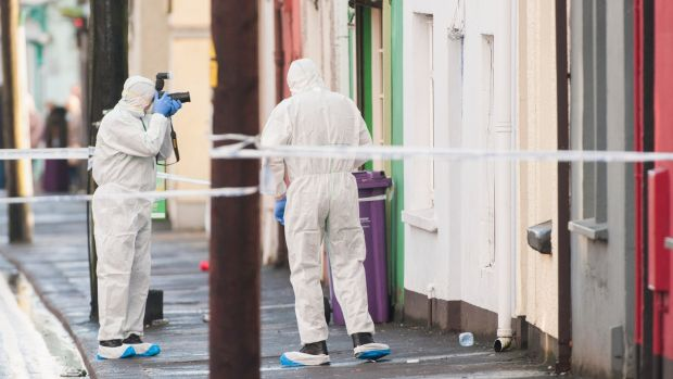 A Garda forensic team pictured on Bandon Road, Cork city on Friday. Photograph: Daragh Mc Sweeney/Provision