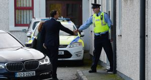Taoiseach Leo Varadkar greeted by an officer at Drogheda Garda Station on Friday. Photograph: Alan Betson