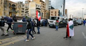 Anti-government protesters block a main highway in Beirut, Lebanon, on Friday. Photograph: AP